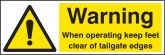 Warning when operating keep feet clear of tailgate edges sign