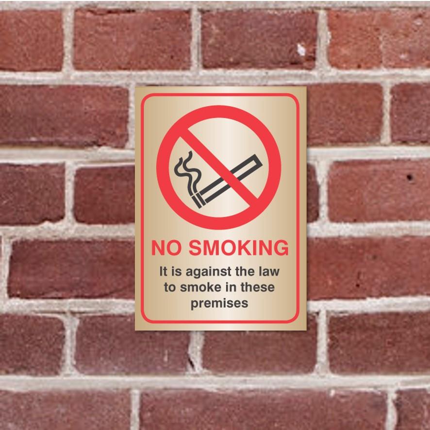brass no smoking law sign